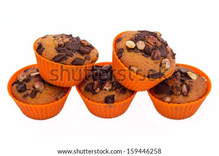 Sweet muffins with chocolate and hazelnut, isolated on white  - stock photo