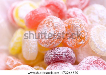 Sweet  multicolor candies on paper, close up - stock photo