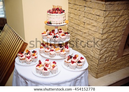 Sweet multilevel wedding cake decorated with flowers. Candy bar