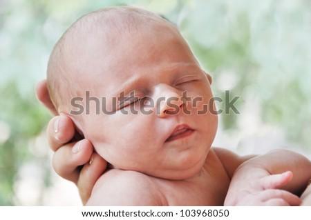 Sweet newborn baby in mother`s hand - stock photo