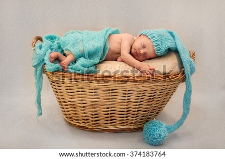 sweet newborn baby sleeping in a basket