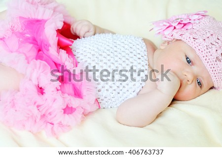 sweet newborn girl is wearing tutu skirt