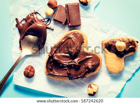 Sweet nougat cream on the heart shape cookies from above  - stock photo