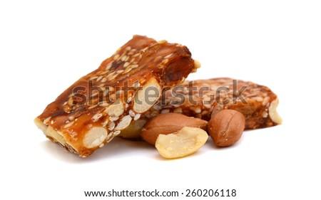 sweet nut bars on white background - stock photo