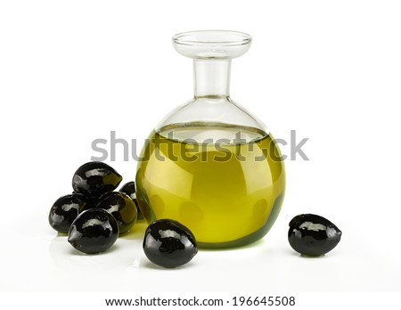 Sweet olives close up / studio photography of a jar with olive oil and some black olives over white background  - stock photo
