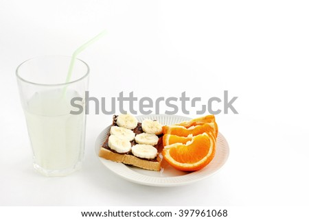sweet oranges and banana on bread with chocolate and fresh drink on white background, health concept, space for your text