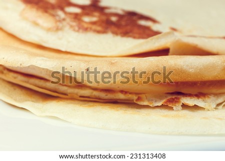 Sweet pancake on white plate