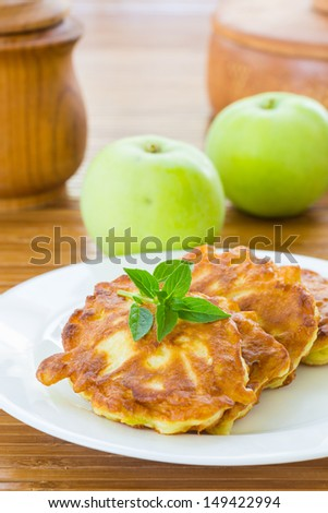 sweet pancakes with apples on a plate - stock photo