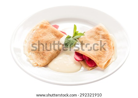 Sweet pancakes with strawberry isolated on white background