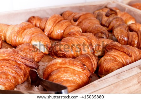 Sweet pastry, Croissants with chocolate and jam filling on shelf in Bakery shop. Pastries in a bakery - stock photo