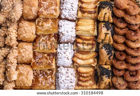 Sweet pastry, puff pastry with powdered sugar, with pine nuts, with jam made from Siam pumpkin, puff pastry with roasted apples and with baked apples. - stock photo