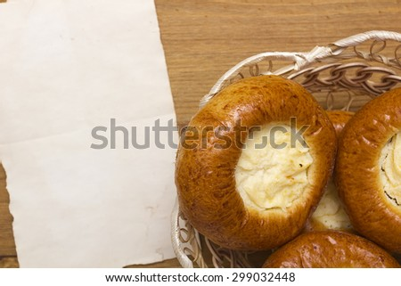 Sweet pastry with ingredients and finished products, buns with cheese. - stock photo