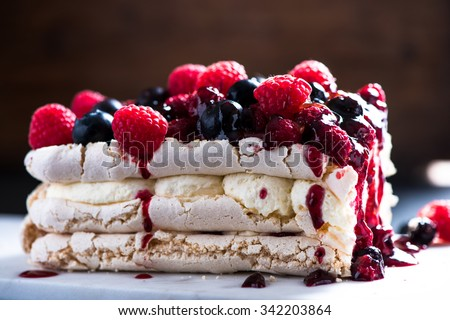 Sweet Pavlova with winter berry fruits - stock photo