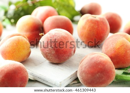 Sweet peach fruit on white wooden table