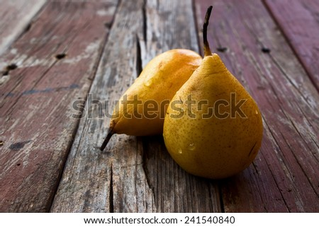 Sweet pear over rustic wooden background. Close up. Selective focus. - stock photo