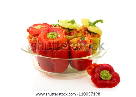 Sweet pepper with vegetable stuffing in a pan for baking on a white background. - stock photo