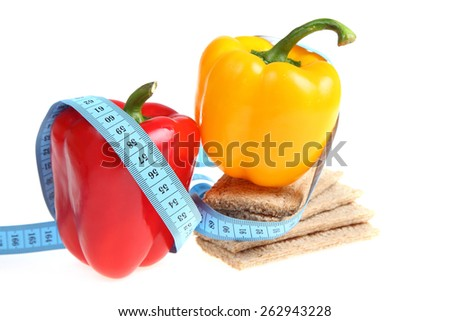Sweet peppers and rye bread with a blue measuring tape. - stock photo