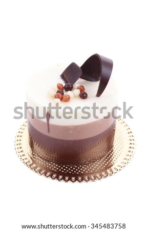 sweet pie layered chocolate milk cake with chocolate on top isolated over white background - stock photo