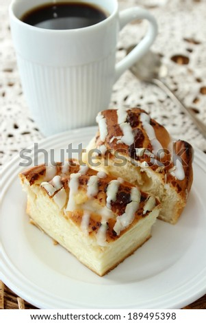 sweet pie with chocolate vanilla icing and caffee cup - stock photo