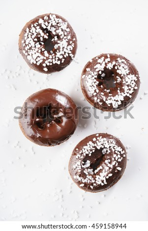Sweet pieces of chocolate doughnuts with chocolate coating