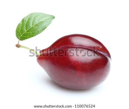 Sweet plum with leaf - stock photo