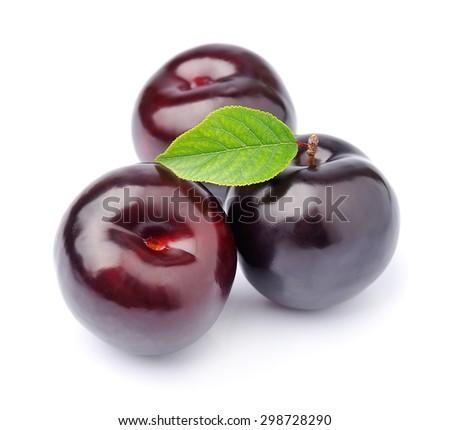 Sweet plums closeup on white - stock photo