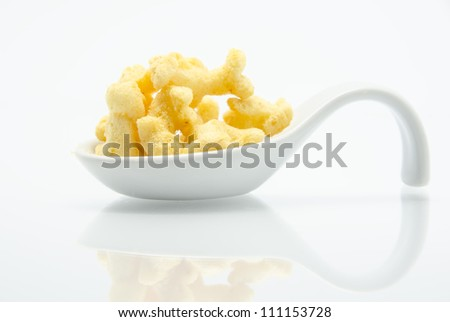 Sweet popcorn in a bucket with reflection - stock photo