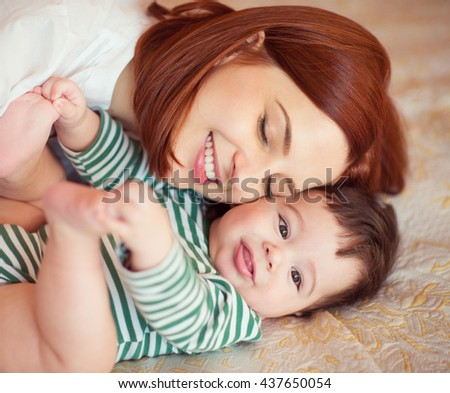 Sweet portrait of happy beautiful mother and baby - stock photo