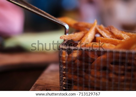 Sweet potato fries served in a wire basket