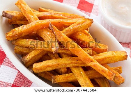 sweet potato fries with dip and checkered napkin - stock photo