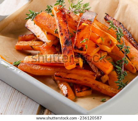 sweet potato fries with fresh herbs . Selective focus