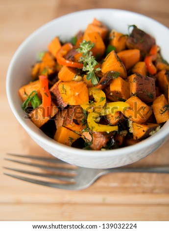 Sweet Potato Hash with Fresh Herbs, Peppers and Onions - stock photo