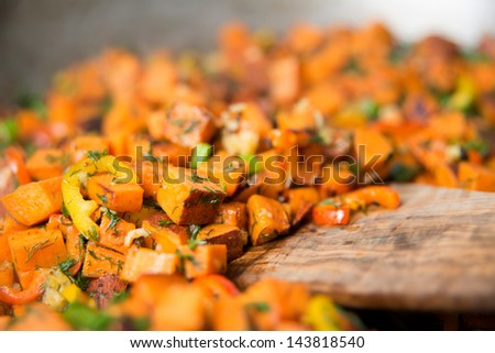 Sweet Potato Hash with Fresh Herbs, Peppers and Onions Cooking in Skillet - stock photo