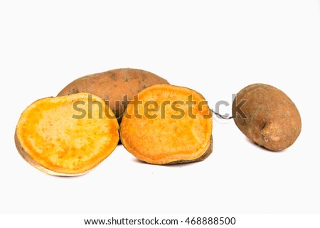 Sweet potato isolated on white background. Sweet potato cut half and whole sweet potato by front view.