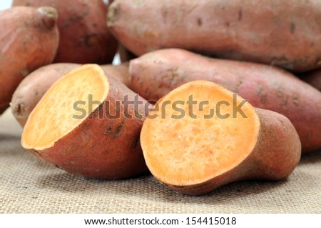 sweet potato on table at market place - stock photo