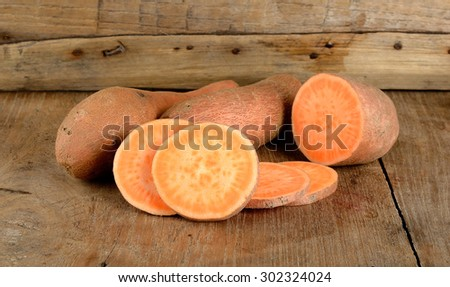 Sweet potato on the wooden background . - stock photo