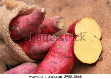 Sweet potato on wood vintage - stock photo