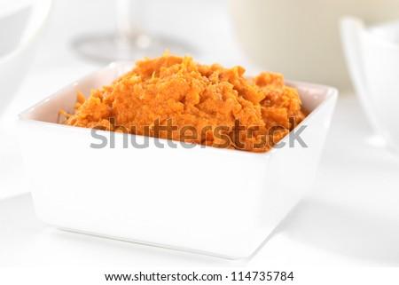 Sweet potato spread in white bowl (Selective Focus, Focus one third into the spread) - stock photo