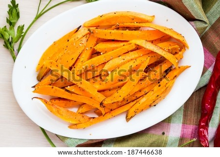 Sweet potatoes, batata, sliced, fried with spices, herb on plate - stock photo