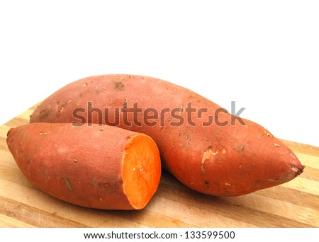 Sweet potatoes halves on wooden surface