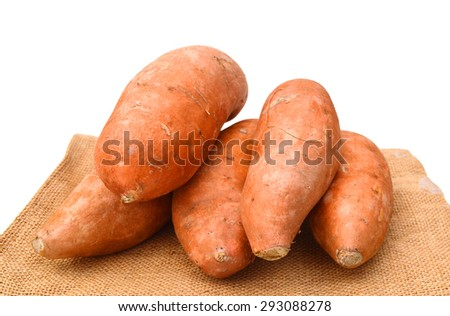Sweet potatoes on purlap a white background.