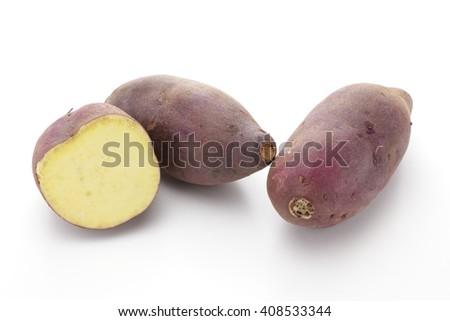 Sweet potatoes on white background  - stock photo