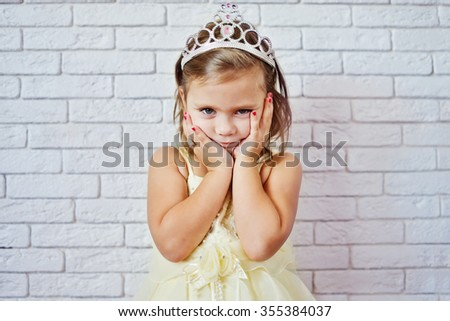 sweet princess girl with crown and red nail