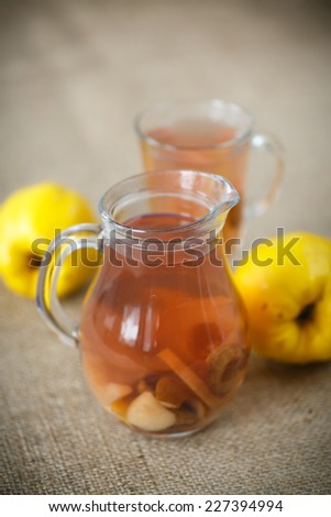 sweet quince compote in a carafe on the table - stock photo