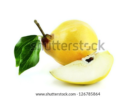 sweet quinces with leaves and slice on white - stock photo