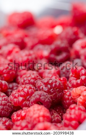 Sweet red raspberries background - stock photo