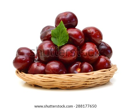 Sweet ripe cherry in basket on white background