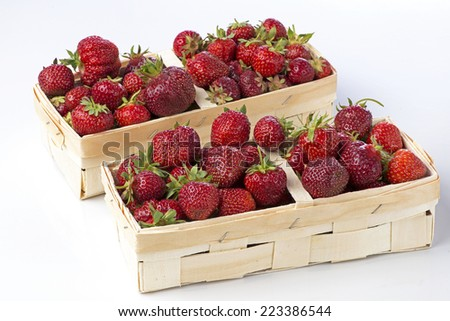 Sweet ripe strawberries in wooden crates. - stock photo
