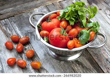 Sweet ripe tomatoes on wooden table - stock photo