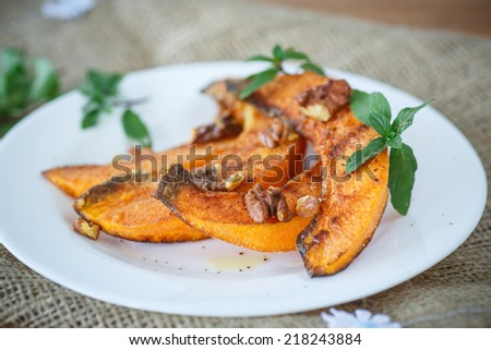 sweet roasted pumpkin with walnuts and sprinkled with cinnamon - stock photo